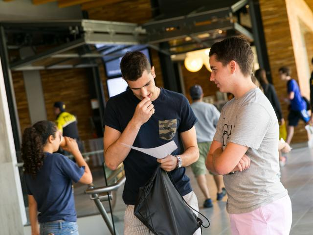 Students looking at papers.